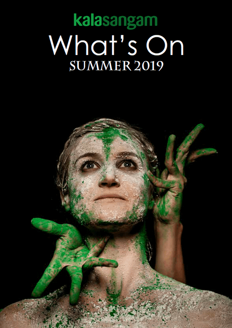Close up of an Asian woman's face covered in green and white paint framed by hands also covered in green paint. Text reads: Kala Sangam What's On Summer 2019